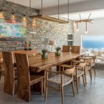Wooden dining table indoors with view to the sea