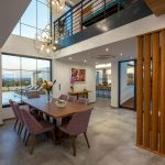 Dining area with wooden details and access to the kitchen