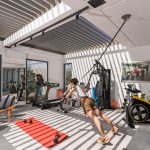TRX session in the fitness room of villa Orizontes