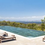 Infinity pool view and blossoming trees