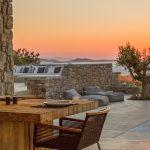 Dine while sun sets at villa Moni in Mykonos