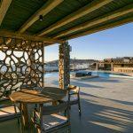 Pool deck of villa Moni in Aleomandra