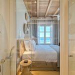 Master bedroom with glass bathroom door