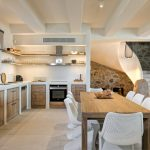 Luxury kitchen and dining table in the new luxury Myconian villa