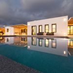 Night lights in the pool at villa Faragas