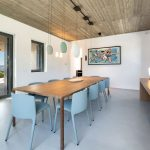 Dining table with pieces of art on the walls